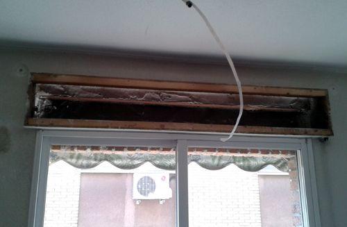 Cajonera de obra y ventanas existentes de aluminio con cristal sencillo: Un delito energético